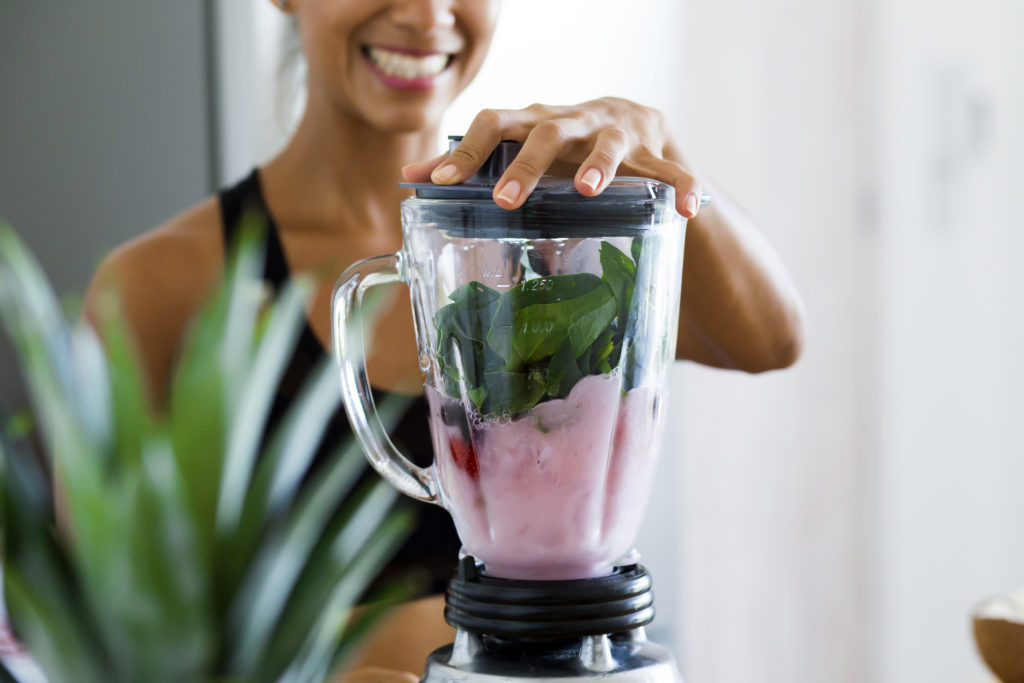 girl making a protein smoothie
